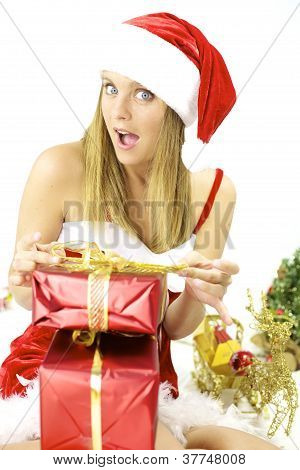 Happy Female Santa Claus Preparing Packages