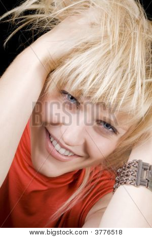 Portrait Of The Smiling Young Beauty Blonde. Isolated