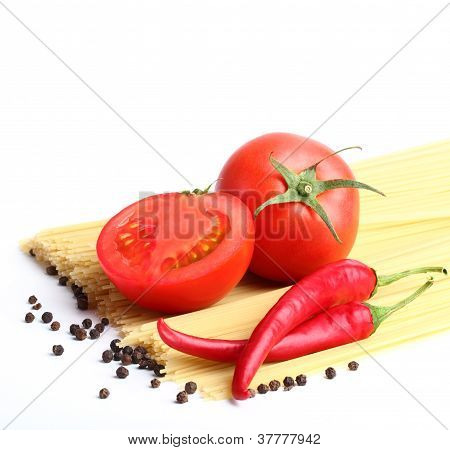 ingredients for tomato sauce and spagetti close-up