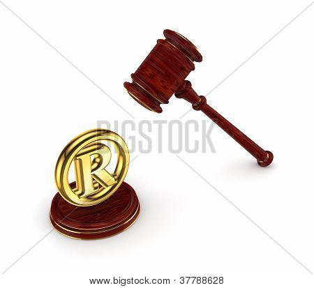 Wooden hammer and copyright symbol.