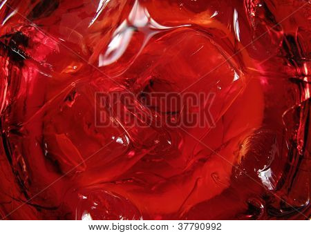 Ice in a red cocktail