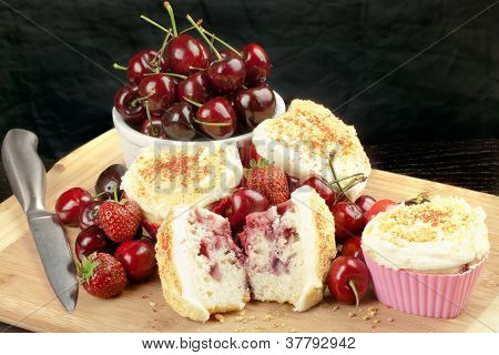 Halved Strawberry Cherry Muffin Surrounded By Fruit And Muffins