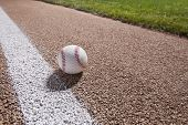 Baseball on base path under night lights