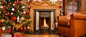 stock photo of cozy hearth  - Christmas interior fire place in a living room in panoramic format - JPG