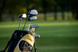 picture of golf bag  - A set up new golf clubs on a beautiful golf course - JPG