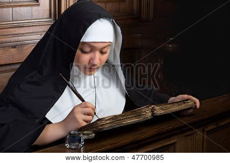 Vintage scene of a young nun writing in an ancient book