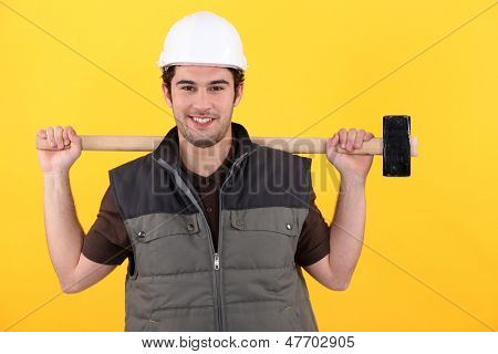 Junge Handwerker lächelnd
