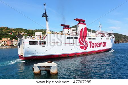 RIO MARINA, ITALY - JUNE 28: Ferry boat Giovanni Bellini cruising to Piombino. Ferry with capacity 700 passengers and 62 vehicles . June 28, 2013 in Rio Marina, Island of Elba, Italy.