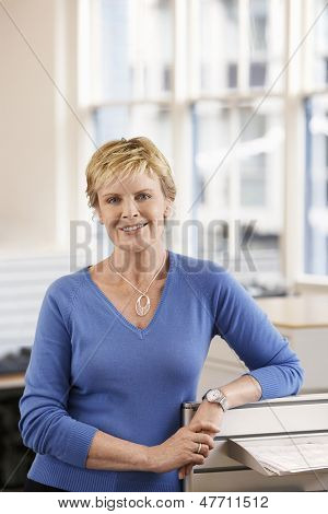 Portrait of confident middle aged businesswoman in office