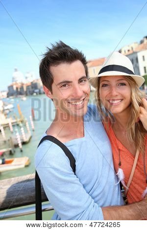 Couple standing on the Academia Bridge in Venice, Italy