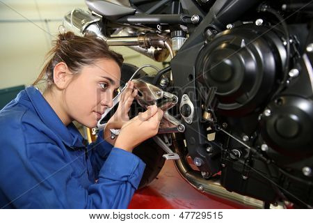 Student girl in motorbike mechanics