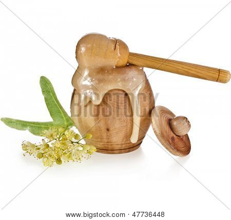 linden honey  in barrel and honey stick isolated on white background