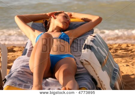 Woman Relaxing On The Chair