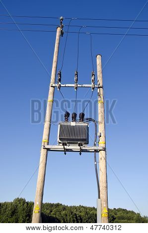 Wooden Utility Pole With Power Lines And Transformer