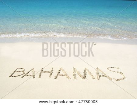 BAHAMAS writing on a desrt beach