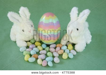 Easter Bunnies With Striped Puzzle Egg.