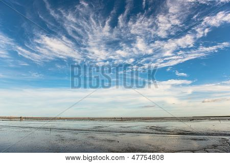 Cloudscape and the sea ebb in the morning