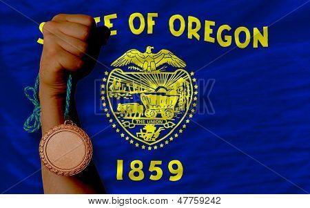 Bronze Medal For Sport And  Flag Of American State Of Oregon
