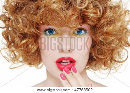 Close-up portrait of young beautiful girl with stylish make-up and shocked expression