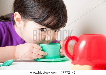 Young Girl Enjoying Her Tea