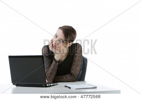Bored Businesswoman At Her Desk