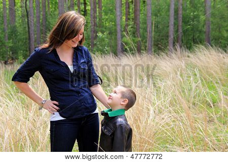 Adorable boy looking up into his mom's face