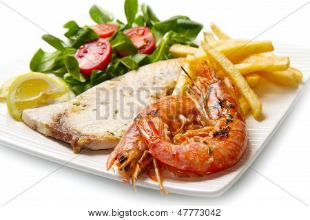 white dish with grilled swordfish and prawn