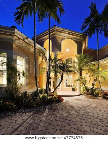 Mansion entrance in a tropical location.