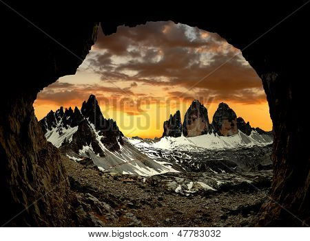 Tre cime di Lavaredo with Paternkofel  at sunset, Dolomite Alps, Italy  View from man-made caves from World War I