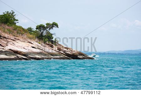 Promontory In Blue Sea