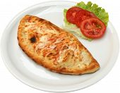 Pizza Calzone with salami bacon cheese  and mushrooms