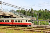 image of railcar  - Commuter train at a railway station at summer - JPG