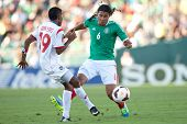PASADENA, CA - JULY 7: Carlos Pena #6 of Mexico and Alberto Quintero #19 of Panama during the 2013 C