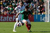 PASADENA, CA - JULY 7: Rafael Marquez #11 of Mexico and Roman Torres #5 of Panama in action during t