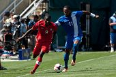 PASADENA, CA - JULY 7: Tosaint Ricketts #9 of Canada & Yoann Arquin #11 of Martinique during the 201