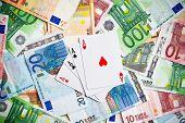 Постер, плакат: покер карты и банкноты евро