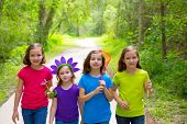 Friends and sister girls walking outdoor in forest track excursion