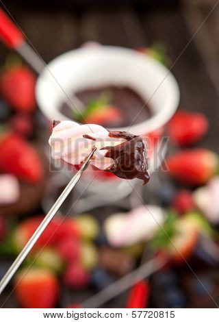 Marshmallow Dipped In Chocolate Fondue