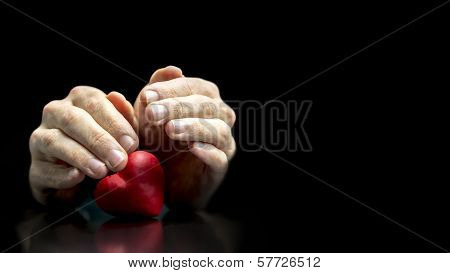 Man Cupping His Hands Protectively Over A Heart