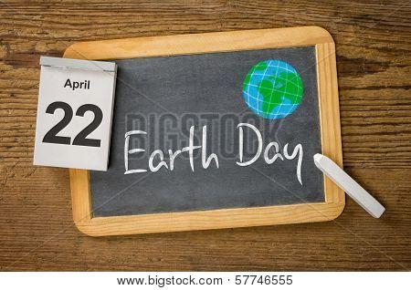 Earth Day April 22 written on a blackboard