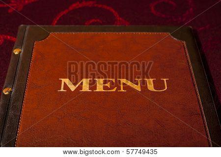 Menu card in leather cover.