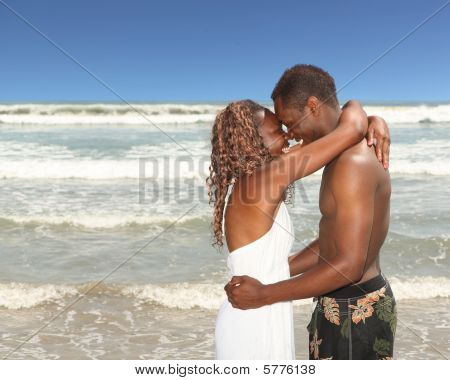 African American Couple On The Beach Happy And In Love