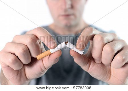 man breaking cigarette quit smoking resolution concept