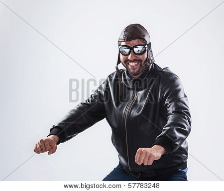 Smiling Man Posing As A Motorcyclist