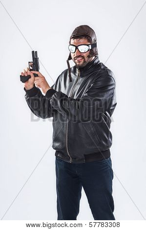 Arrogant Young Man Holding A Gun Pointed Upwards