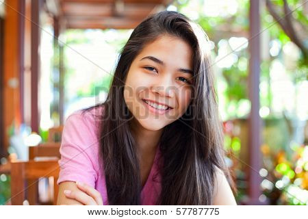 Young Teen Girl Relaxing Outdoors On Veranda