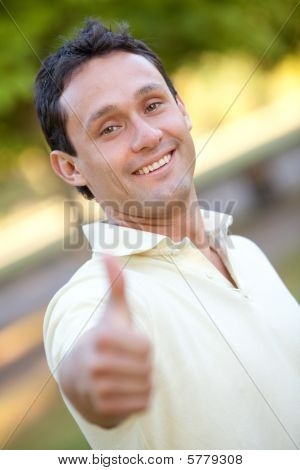 Man With Thumbs Up Outdoors