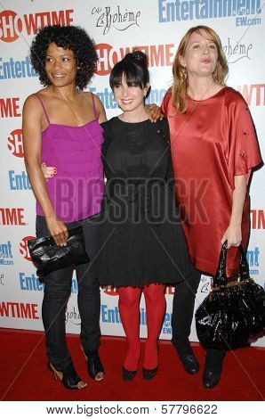 Rose Rollins with Mia Kirshner and Laurel Holloman  at the farewell party for final season of 'The L Word'. Cafe La Boheme, West Hollywood, CA. 03-03-09