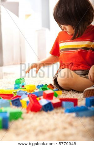 Toddler Boy Building With Blocks