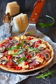 picture of hot fresh pizza  - Hot rustic pizza on pizza maker shove - JPG